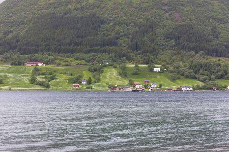 Typical Norwegian village on the fjord. Lofoten islands in Norway. Banco de Imagens