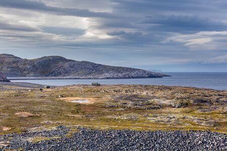 Small russian village Teriberka on the Barents sea coast. Kola peninsula, Murmansk Oblast, Russia.