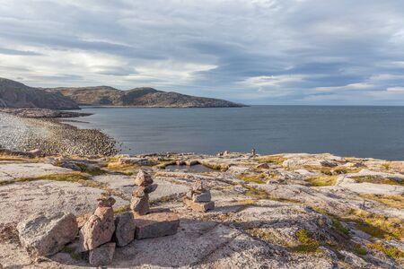 Colorful rocky landscape of northern tundra in autumn season. Wild nature of Russian North near Teriberka. Kola Peninsula, Murmansk Oblast, Russia