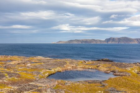 Colorful rocky landscape of northern tundra in autumn season. Wild nature of Russian North near Teriberka. Kola Peninsula, Murmansk Oblast, Russia Stock Photo
