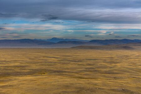 Dry Mongolian landscapes in the Altai Mountains, wide landscape. Stock Photo