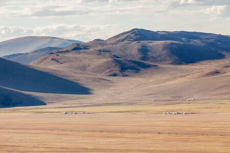 the mongolian kazakhs of western mongolia migrate each year with their herd of camels. horses, sheep, cows and goats in the snowy altai mountain, from camp to camp