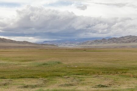 Mongolian landscape, green pastures in the hills of Mongolia.