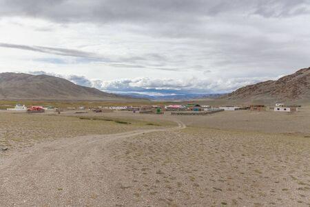 A winding road suitable for a small settlement in the Altai mountains of Mongolia