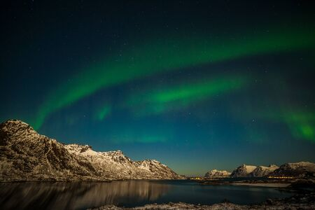 Aurora Borealis in Tromso, Norway in front of the Norwegian fjord, winter season, long shutter speed. Nature of Norway Imagens