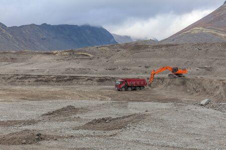 Construction machinery works on quarry mining in the Khibiny mountains, Kola Peninsula.