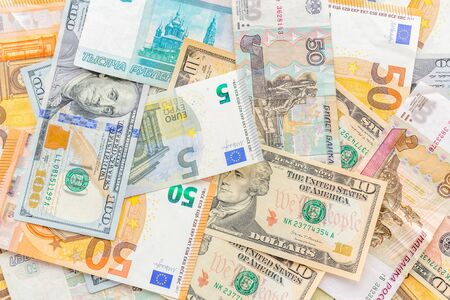 Cash money of various countries dollars, rubles, euro Top view.