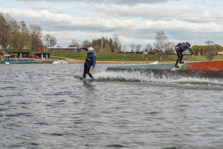 Fagersta, Sweden - Maj 01, 2020: Two teenagers wakeboarders on a lake during a physical education lesson.