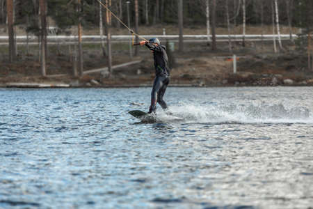 Fagersta, Sweden - Maj 01, 2020: Teenager wakeboarding on a lake during a physical education lesson. Redactioneel