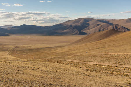 Typical view of Mongolian landscape. Mongolian Altai, Mongolia, Mongolian nomad on a motorcycle Stockfoto