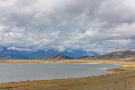 Wild mountain lake in the Altai mountains, summer landscape, Mongolia landscape. Altai Tavan Bogd National Park in Bayar-Ulgii. Scenic valley on the background of the snowcapped mountains