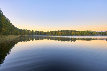 Sunrise reflection over Finnish lake