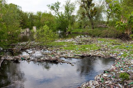 water feature: Rubbish, of plastic bottles thrown by people, blocked the river. Stock Photo