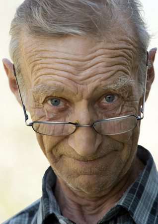 cheerfully: Cheerfully smiling elderly the man in glasses Stock Photo