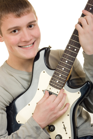 keen: The young man is keen playing on an electroguitar