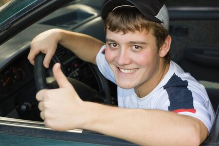teenage male: Young man in the cabin while driving