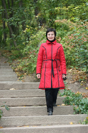 The smiling woman in autumn park
