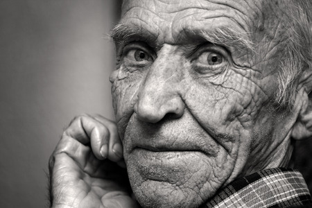 white face: Face of the old person, in wrinkles, black and white