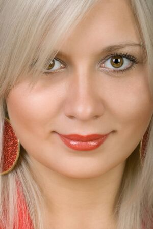 women face stare: Portrait of the smiling blonde close up Stock Photo