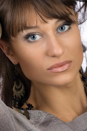 Brunette with dark blue eyes Stock Photo