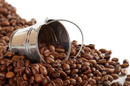 Coffee beans in a metal bucket isolated