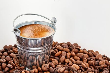 A bucket of coffee in coffee beans on a white isolated background Stockfoto