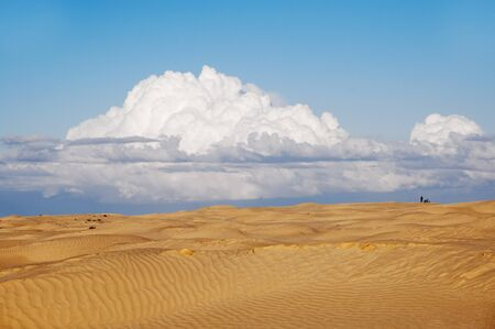 lonesomeness: A lonely figure of a man and a motorbike in the desert