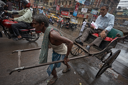 Kolkata, India, September 2007. Rickshaw puller working in the streets of the city. Editöryel