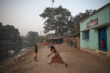 Kalighat, Kolkata, India, January 2008. Children playing in a slum near a contaminated river.