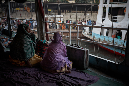 Dhaka, Bangladesh, January 2008. Two women are waiting for the ferry to depart at the Sadarghat launch terminal.