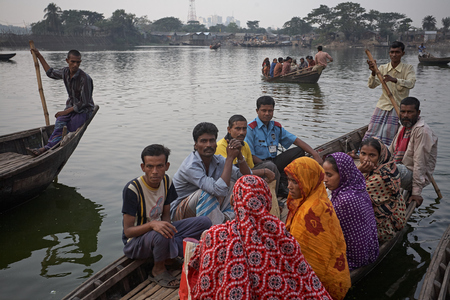 Dhaka, Bangladesh, January 2008. Passengers waiting to cross the Buriganga River in a rowboat. Editöryel