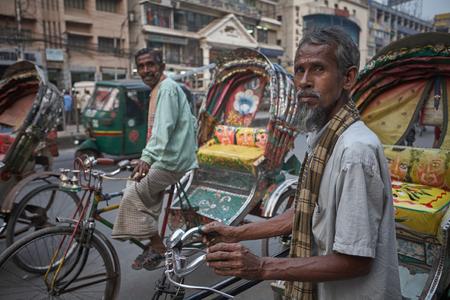 Dhaka, Bangladesh, January 2008. Rickshaw drivers waiting for passengers.