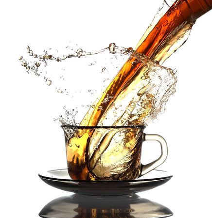 green herbs: Pouring Healthy Tea Stock Photo
