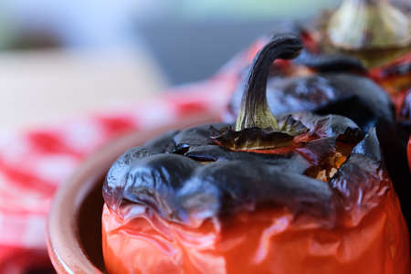 closeup of burnt pepper stuffed with rice