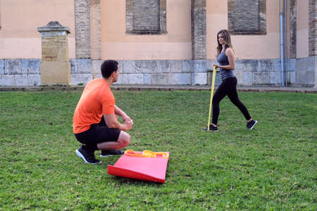 young couple doing sport in park with joy. Concept sport healthy life companionship Archivio Fotografico