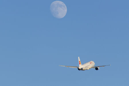 departing: An Iberia Express Airbus A320-200 departing at Malaga whith the moon rising. Editorial
