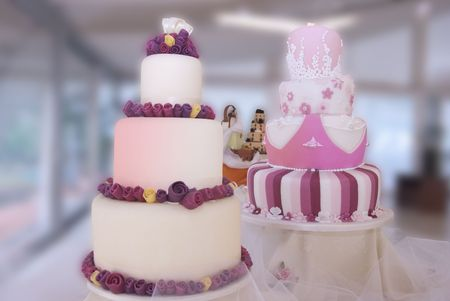 display of artistic wedding cakes