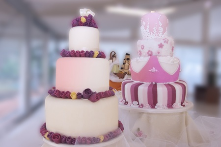 display of artistic wedding cakes photo