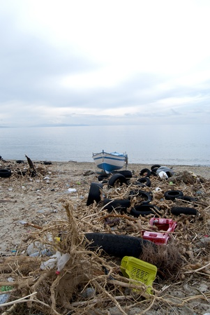 environmental pollution  A beach oh the Calabria with waste and polluting material photo