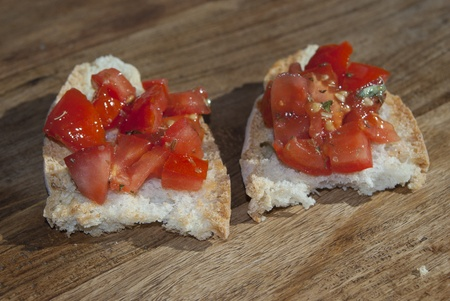 seasoned: toasted bread seasoned with oil and garlic and often diced tomatoes Stock Photo