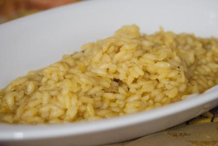 Italian cuisine. Forst dish:saffron risotto photo