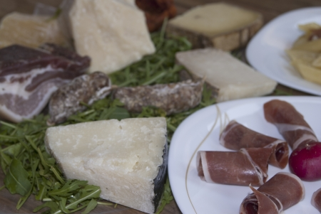 composition of ham , salami and cheeses, typical Italian appetizer. photo