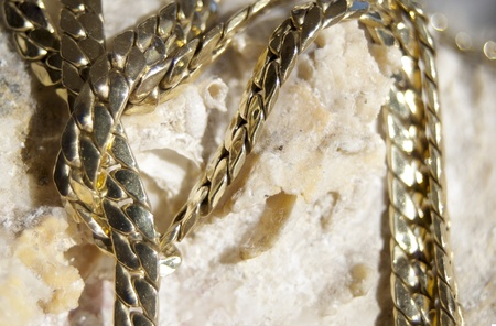 welth: welth  gold jewelry in the foreground Stock Photo