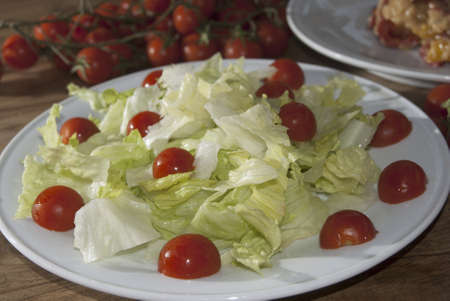 appetize: lettuce salad with pachino tomatoes a healthy vegetarian meal