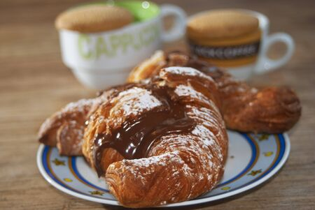 ingest: Italian breakfast at the bar: croissant with chocolate
