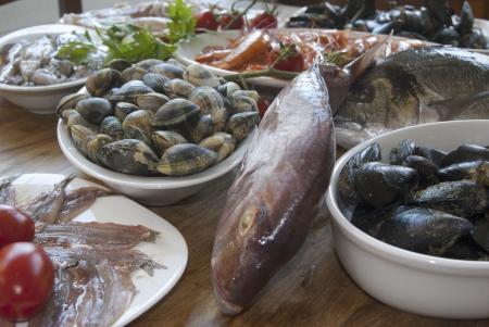fresh bluefish: healthy raw fish mixed photo