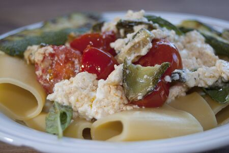 tradional: a tradional Italian recipe: paccheri with ricotta, zucchini nd tomatoes Stock Photo