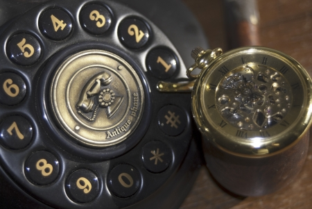 Vintage  some old objects  An old watch and a telephone photo