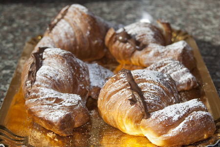 a traditional Italian dessert for the breakfast: chocolate croissant photo