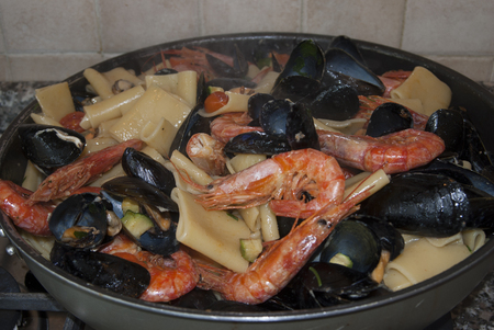 seafruit: Traditional Italian sea dish:pasta with mussels prawns and zucchini